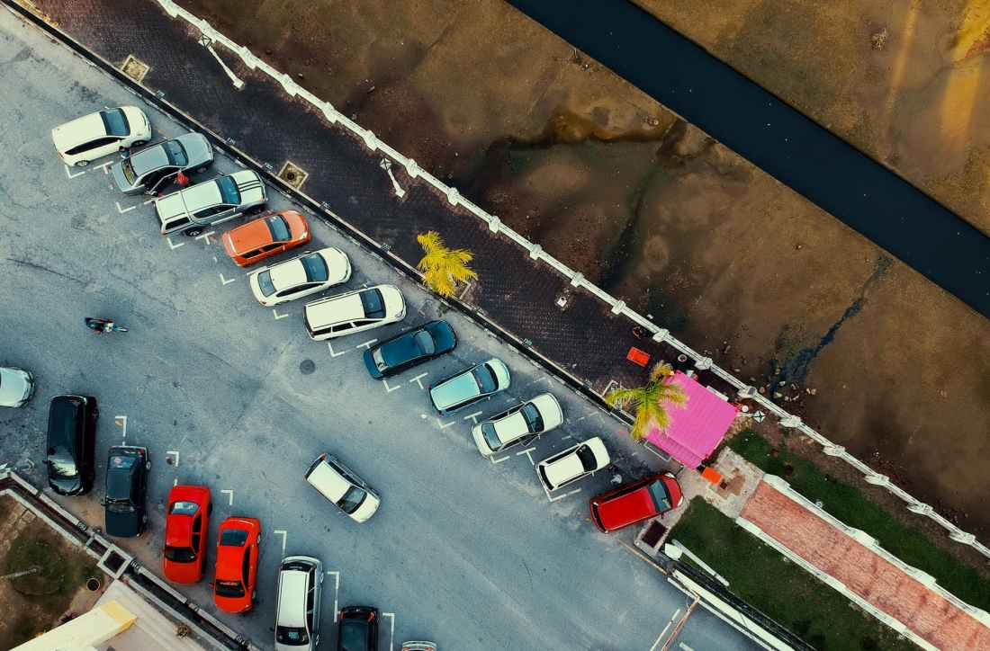bird s eye view of parked cars