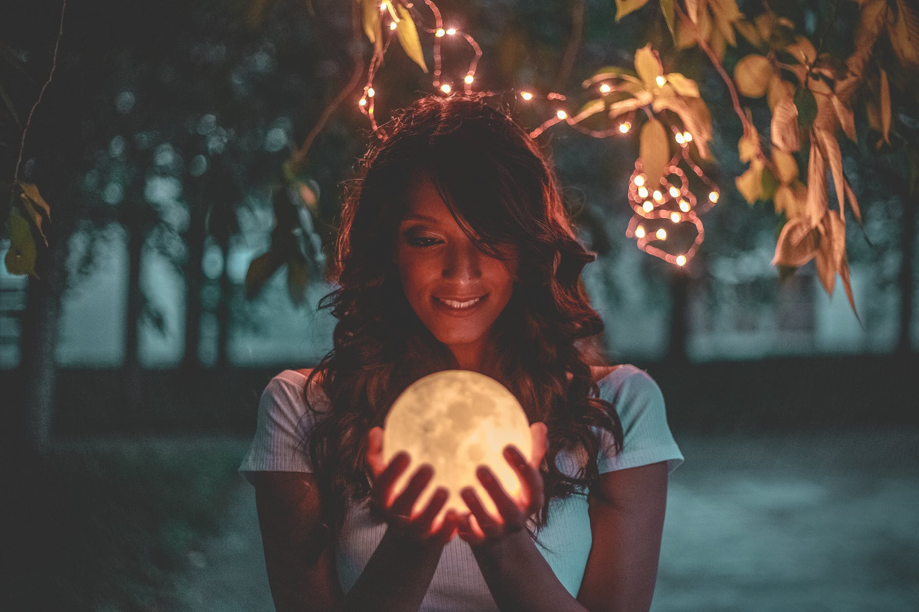 woman holding moon lamp